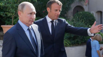 France's Macron urges Putin to respect democracy