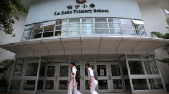 Hong Kong Shuts Down Schools Again as Virus Cases Surge
